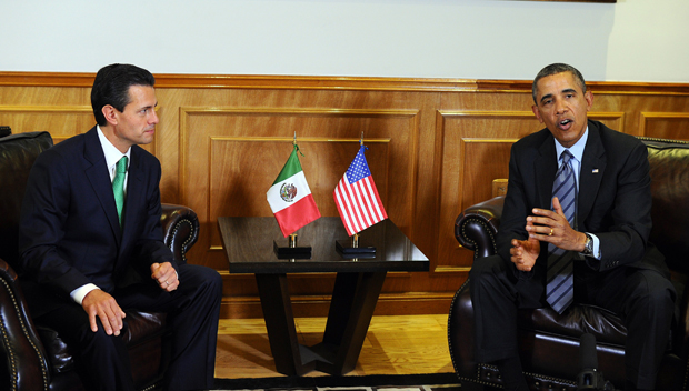 US President Barack Obama holds a bilateral meeting with Mexican President Enrique Pena Nieto (L) at the Palacio de Gobierno del Estado de Mexico in Toluca, Mexico, on February 19, 2014.