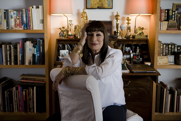 Anjelica Huston sits in her home.