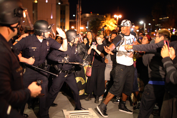 Protesters and police clash in front of LAPD Headquarters as people react to the grand jury decision not to indict a white police officer who had shot dead an unarmed black teenager in Ferguson, Missouri, in the early morning hours of November 25, 2014 in Los Angeles, California. David McNew/Getty Images