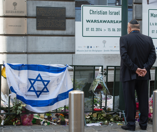 A man takes part in a solidarity ceremony of the World Jewish Congress after the killings at the Jewish museum in Brussels on June 2, 2014. Three people were reported dead, two Israeli tourists and a French woman working as a volunteer at the museum.