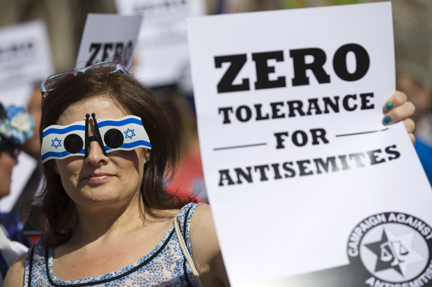 """Jewish groups protest outside the Royal Courts of Justice in London on August 31, 2014, as they call for """"Zero Tolerance for Anti-Semitism"""". Jewish groups demonstrated outside the British High Court as latest figures published by the Community Security Trust reported a spike in anti-semitic attacks on people and property in the UK following the latest outbreak of violence between Israel and Palestinians in Gaza."""