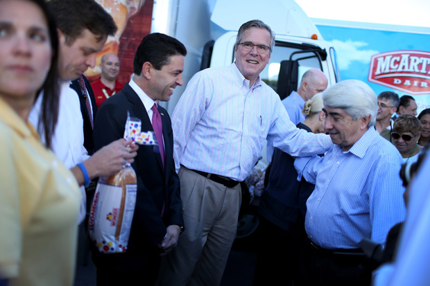 Former Florida Governor Jeb Bush hands out items for Holiday Food Baskets to those in need on December 17, 2014 in Miami, Florida. Bush recently launched two new fundraising PACs.