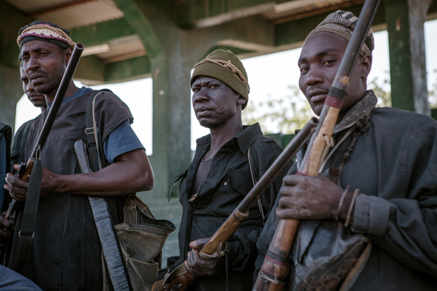 A band of hunters pose in Yola, state capital of Adamawa, on December 4, 2014 after taking part in an operation against Nigerian Islamist extremist group Boko Haram. Military and vigilantes forces acknowledge the crucial support of hunters in the fight against Boko Haram.