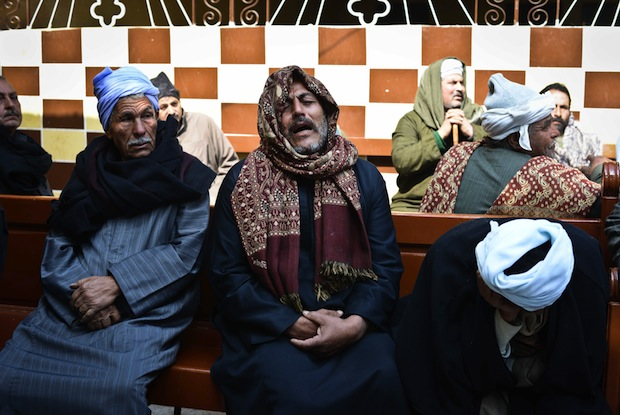 Relatives of Egyptian Coptic Christians purportedly murdered by Islamic State (IS) group militants in Libya react after hearing the news on February 16, 2015 in the village of Al-Awar in Egypt's southern province of Minya