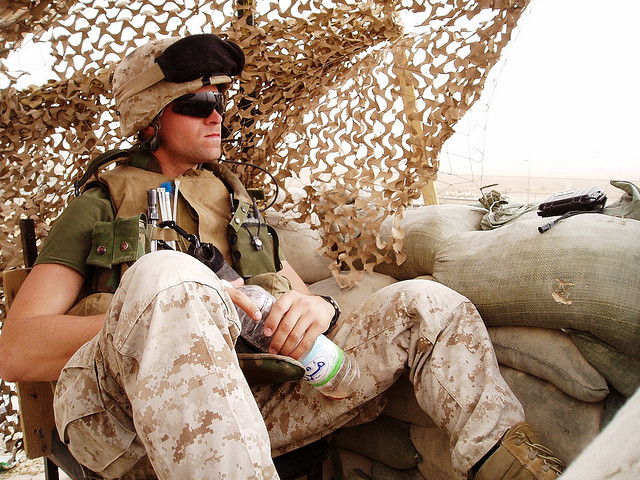 A Marine sits atop an operating base in Iraq.