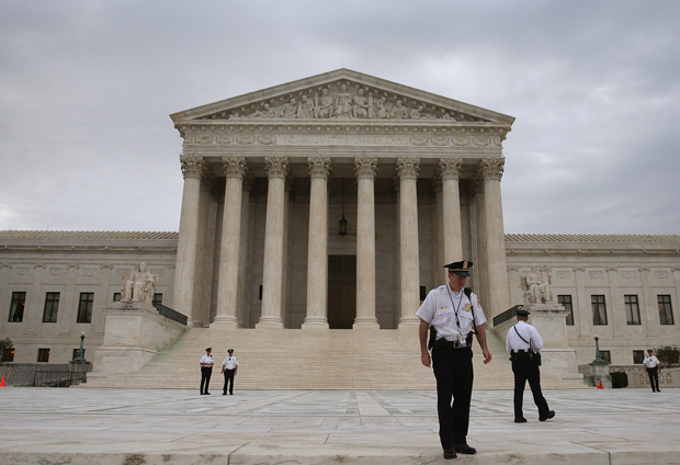 Police stand in front of the U.S. Supreme Court in Washington, D.C.