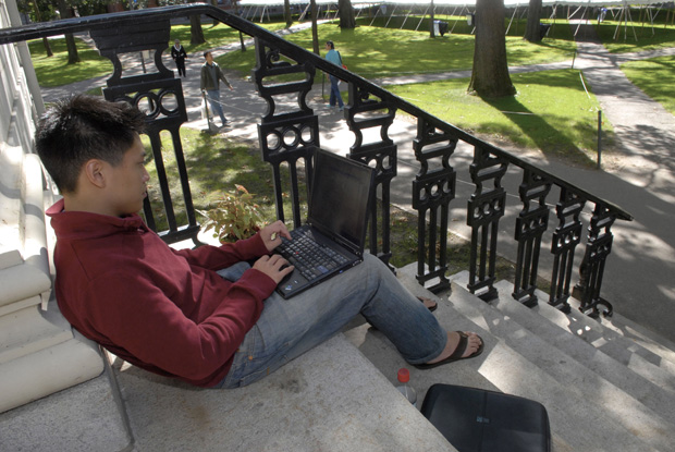 This file photo shows Freshman Chris Chen working on his notebook computer on the campus of Harvard University in Cambridge, Massachusetts.