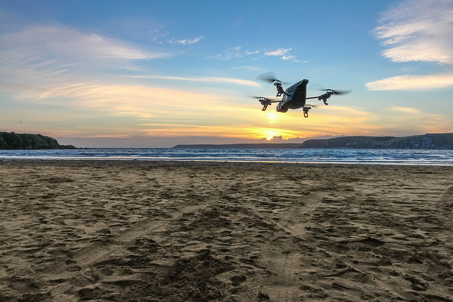 A drone flies over a beach in England.