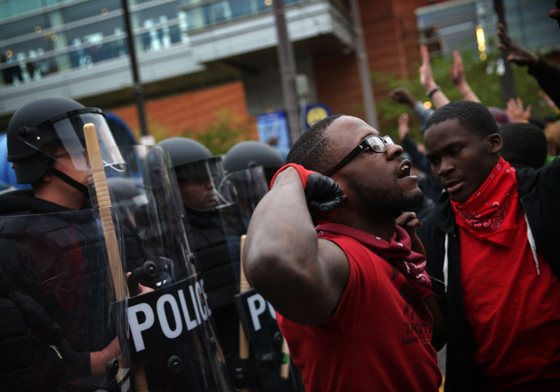 Protesters stand off with police during a march in honor of Freddie Gray on April 25, 2015 in Baltimore, Maryland.