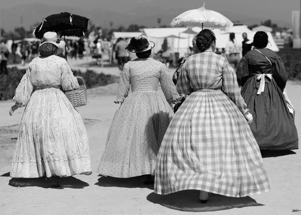 This 2012 photo shows women walking through the camp to participate during the Heritage Days and Civil War Reenactment at Pierce College Farm Center in Woodland Hills, California.