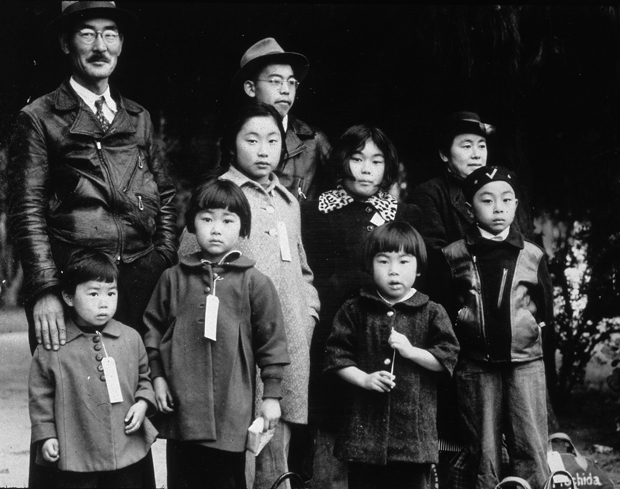 Members of the Japanese-American Mochida family in Hayward, California, awaiting re-location to a camp.