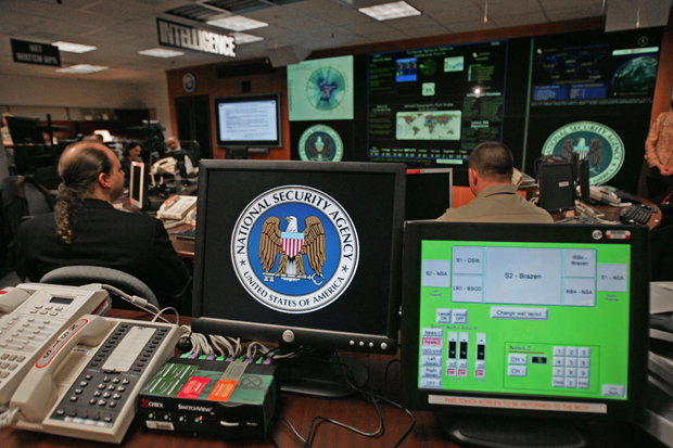 A computer workstation bears the National Security Agency (NSA) logo inside the Threat Operations Center in the Washington suburb of Fort Meade, Maryland.