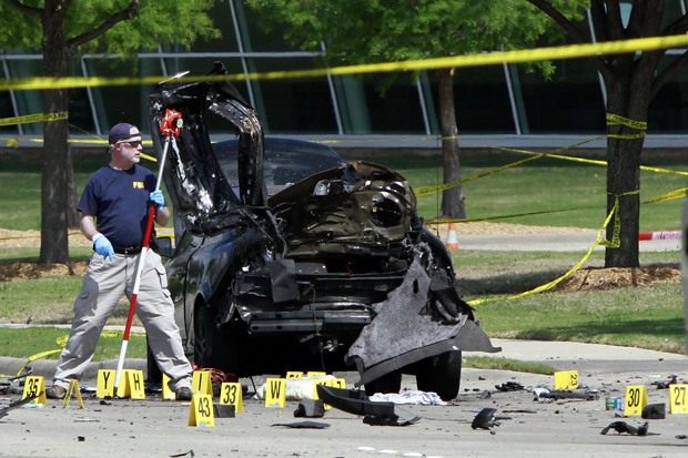 Members of the FBI Evidence Response Team investigate a crime scene May 4 outside of the Curtis Culwell Center after a shooting in Garland, Texas.