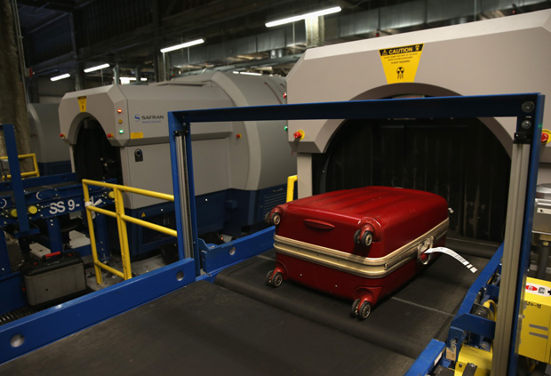 A 2014 photo shows luggage moving through an explosives detection system at the Newark Liberty International Airport in New York City.