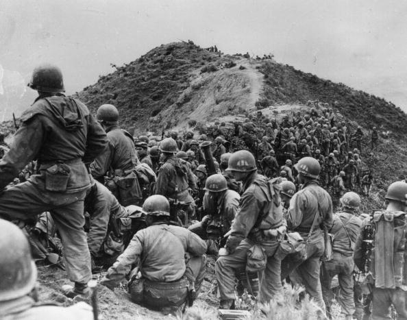 Men of the 187th US Regimental Combat Team prepare to take a ridge position somewhere in Korea in May 1951.
