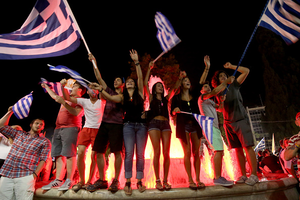 People celebrate in front of the Greek parliament July 5 as the people of Greece reject the debt bailout by creditors.