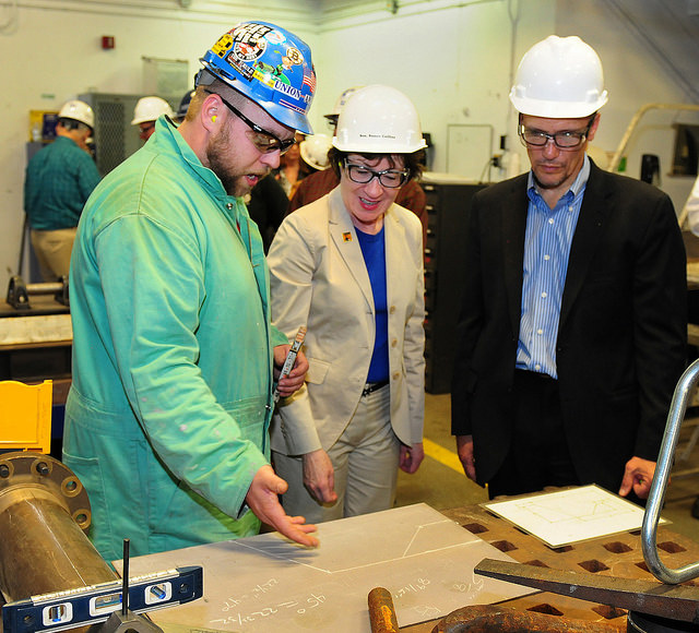 This May photo from the Department of Labor shows, from left, a student at the Trades Learning Center at Bath Iron Works (BIW) describing his work to U.S. Sen. Susan Collins (R-Maine) and U.S. Secretary of Labor Thomas Perez.