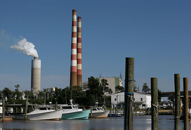 Boats are docked at the Aqualand Marina as emissions spew out of a large stack nearby at the coal-fired Morgantown Generating Station  in Newburg, Maryland.