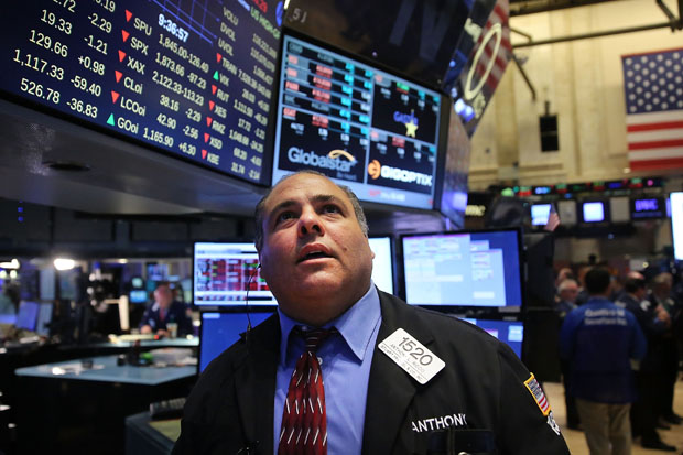 A trader works Aug. 24 on the floor of the New York Stock Exchange (NYSE)  in New York City. As the global economy continues to react from events in China, markets dropped significantly around the world.