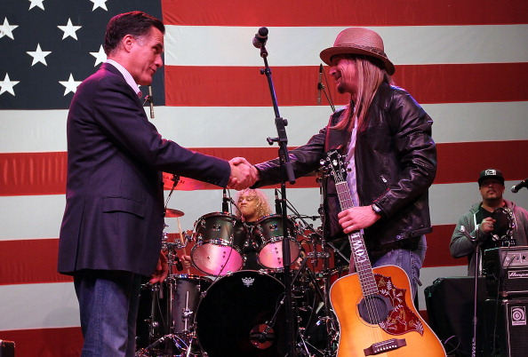 Then-Republican presidential candidate and former Massachusetts Gov. Mitt Romney (L) greets musician Kid Rock during a 2012 campaign rally at the Royal Oak Theatre  in Royal Oak, Michigan.