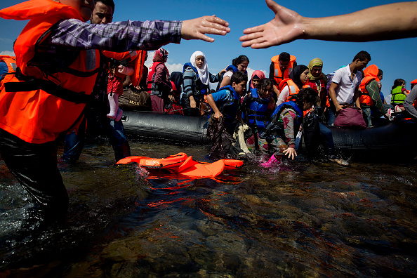 Refugees come ashore Sep. 8 near the village of Skala Sikamineas in Lesbos, Greece.