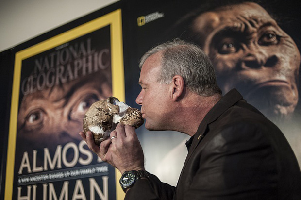 Professor Lee Berger kisses the skull of a Homo Naledi , a newly-discovered human ancestor, during the unveiling of the discovery Sept. 10 in Maropeng.
