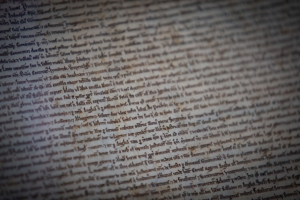 A copy of the Magna Carta on display in Salisbury Cathedral's Cloisters and Chapter House on Feb. 27, in Salisbury, England. To celebrate the 800th anniversary of the historic charter, the cathedral — which boasts to have the best-preserved Magna Carta of the four originals — opened a new interactive exhibition on the document, its creation and legacy.