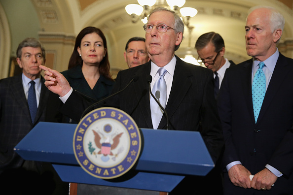 Senate Majority Leader Mitch McConnell (R-Ky.), center, and fellow GOP leaders talk to reporters on Tuesday. The Senate passed a defense authorization bill by a vote of 91-3, sending it back to President Obama with language that would make it hard for him to close the Guantanamo Bay prison before he leaves office in 2017.