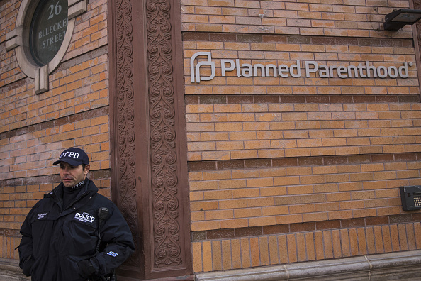A New York City police officer from the counterterrorism department stands guard outside a Planned Parenthood location in the city on Monday. Gov. Andrew Cuomo ordered increased security at Planned Parenthood offices throughout the state.