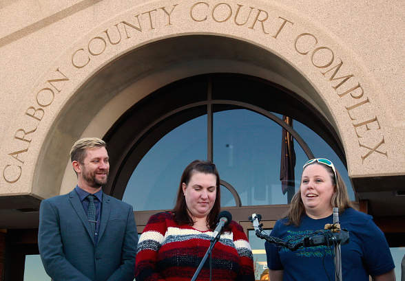 Troy Williams, left, the Executive Director of Equality Utah, April Hoagland, center, and her wife Beckie Peirce, right, talk to the press after a Utah juvenile judge amended an order to remove the couple's foster child from their home on Nov. 13 in Price, Utah.