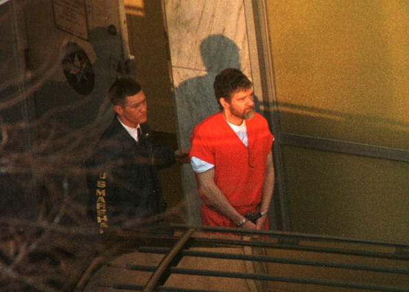 Theodore Kaczynski is led out of the federal courthouse in Sacramento, California, by a U.S. Marshal after a hearing to determine his competency on Jan. 20, 1998.