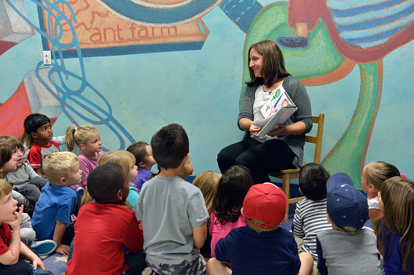 KinderCare Pre-School teacher Kimberly Bouchie reads to her students prior to being presented with the Knowledge Universe Early Childhood Educator Award.