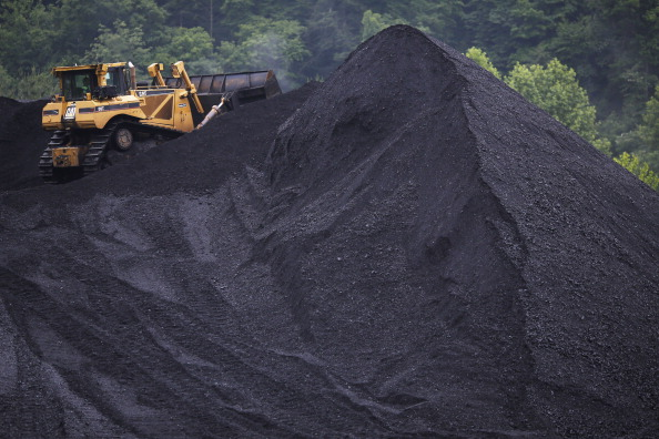 A bulldozer operates atop a coal mound at the CCI Energy Slones Branch Terminal June 3, 2014, in Shelbiana, Kentucky.