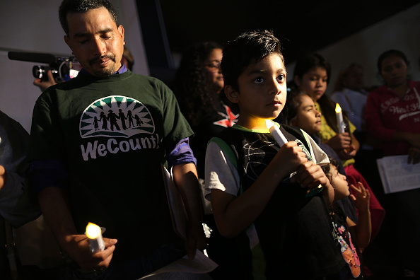 Bryan Gonzalez, whose family is originally from Mexico, attends a vigil with others to protest against the deportation of undocumented immigrants on Jan. 6 in Homestead, Florida.