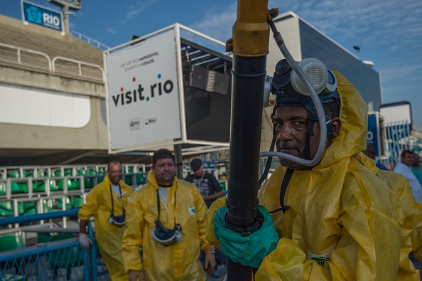 """Municipal agents spray against at the Sambadrome in Rio de Janeiro on January 26. Brazil mobilized more than 200,000 troops to go """"house to house"""" in the battle against Zika-carrying mosquitoes."""