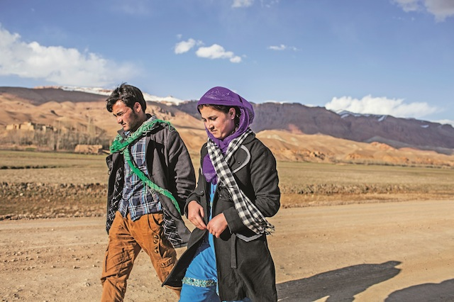 This picture of Zakia and Ali on the run, first published in <em>The New York Times</em>, has become iconic, with many Afghan artists painting versions of it.