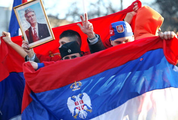 Serbian protestors wave Serbian flags and hold a picture of Bosnian Serb war crimes suspect Radovan Karadzic during an anti-Kosovo independence rally in Belgrade on February 21, 2008.