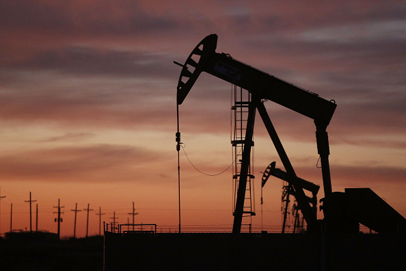 An oil pumpjack works at dawn in the Permian Basin oil field on January 20, 2016 in Andrews, Texas.