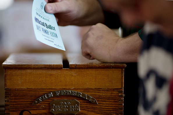 A voter casts their ballot on February 9 in Chichester, New Hampshire.