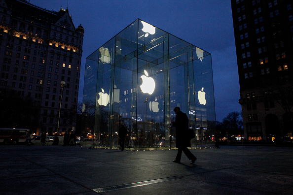A man walks outside the Apple store on the Fifth Avenue in New York on February 17. Apple's challenge of a court order to unlock an iPhone used by one of the San Bernardino killers opens up a new front in the long-running battle between technology companies and the government over encryption.