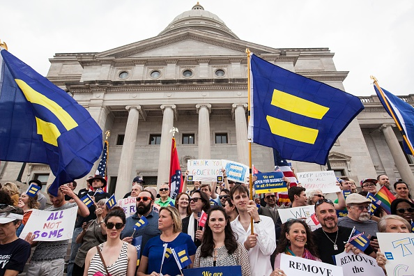 Demonstrators gather on the steps of the Arkansas State Capital in Little Rock in April 2015 after Gov. Asa Hutchinson said he wouldn't sign a bill on religious freedom into law. Now, similar bills that are allegedly written to protect religious freedom, but which opponents say enable discrimination, have been passed in several southern states.