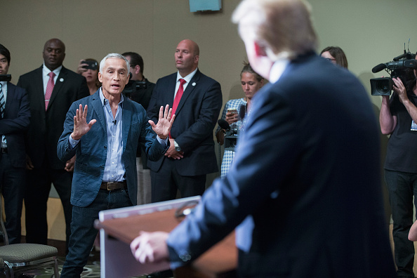 Univision and Fusion anchor Jorge Ramos asks Republican presidential candidate Donald Trump a question during a press conference on August 25, 2015 in Dubuque, Iowa. Earlier in the press conference Trump had Ramos removed from the room when he failed to yield when Trump wanted to take a question from a different reporter.