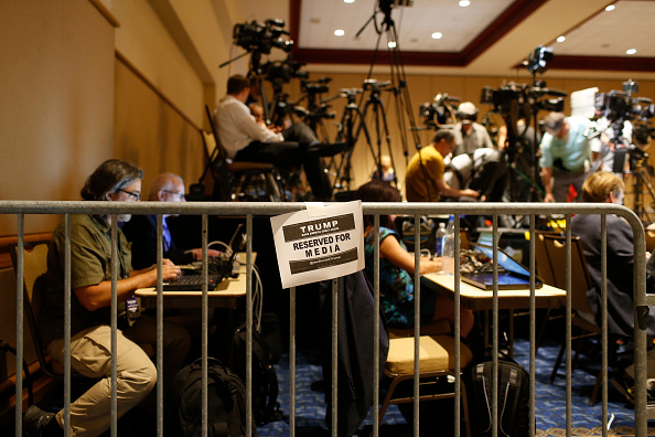 Members of the media work inside the controversial 'designated media pen' as they wait for Republican presidential candidate Donald Trump to arrive on March 14 in Tampa , Florida.