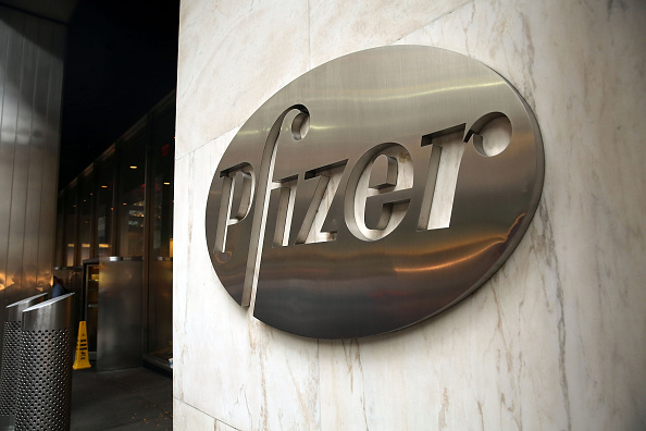 Pfizer's corporate headquarters stand in midtown Manhattan on November 12, 2015 in New York City. The drug company had planned a merger with Ireland-based Allergan that would have lowered its U.S. tax bill, but new tax rules led the companies to back out of the deal on April 6.