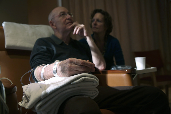 Youssef Cohen, 68, sits while undergoing cancer treatment as his wife Lindsay Wright looks on, on March 17 in New York City. He is currently taking immunotherapy infusions of the drug Keytruda in a final effort to fight his incurable cancer called mesothelioma.