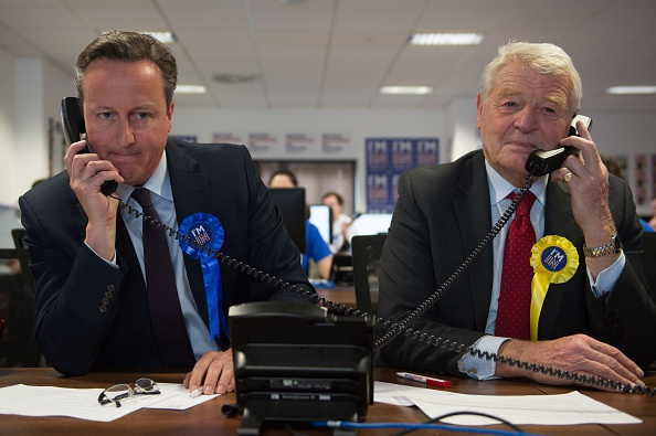 British Prime Minister David Cameron (L) and former Liberal Democrats leader Paddy Ashdown (R) make campaign calls for Britain Stronger in Europe, the official 'Remain' campaign organisation for the forthcoming EU referendum, in London on April 14.