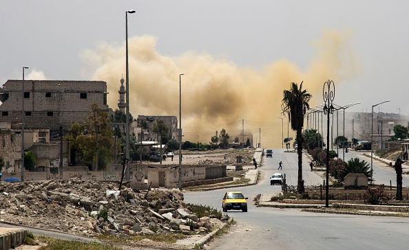 Smoke is seeing rising on a main road in the Salihin neighbourhood of Syria's northern city of Aleppo following a reported air strike on April 24.