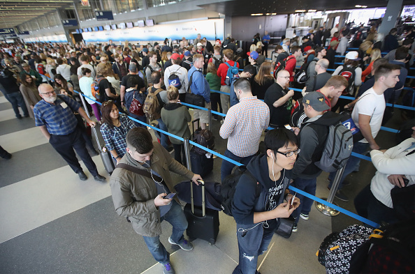 Passengers at O'Hare International Airport wait in line to be screened at a Transportation Security Administration (TSA) checkpoint on May 16 in Chicago, Illinois.
