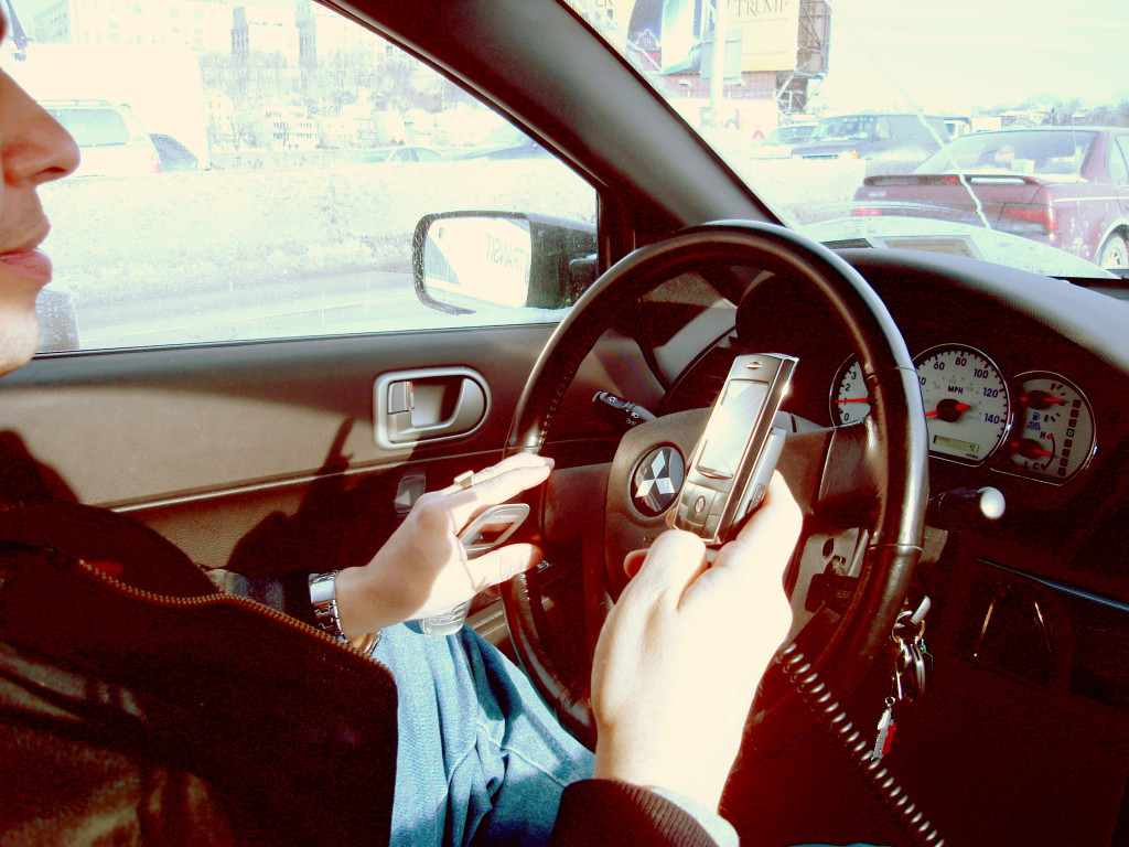 A driver in New York uses two mobile phones at once.