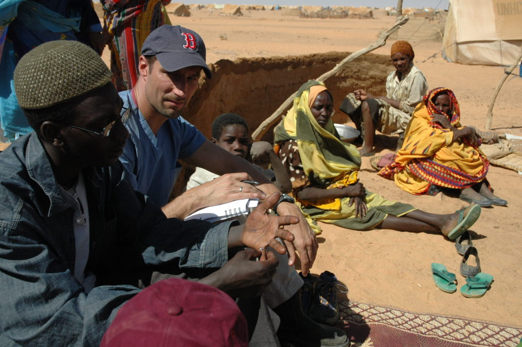 Michael VanRooyen interviewing Darfuri refugees at Kashuni Camp, Chad in 2005.